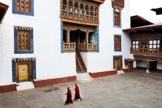 Monks Walking Through the Courtyard of Punakha Dzong, Punakha District, Bhutan, Asia-Jordan Banks-Photographic Print