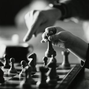 Monochromatic Image of an Adult and Child Playing Chess