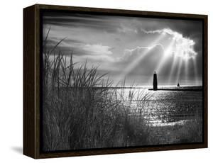 Frankfort Lighthouse and Sunbeams, Frankfort, Michigan '13 by Monte Nagler