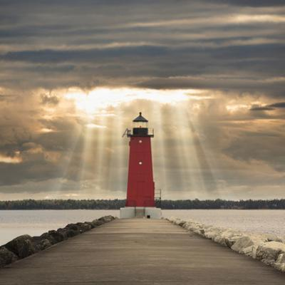 Manistique Lighthouse and Sunbeams, Manistique, Michigan '14 by Monte Nagler