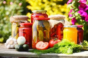 Jars Of Pickled Vegetables In The Garden. Marinated Food by monticello