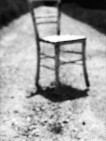 Empty Straight-Backed Chair in Spotlight by Monzino