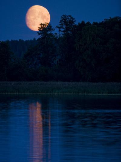 Moon Light Reflecting in Calm Lake Water-Mattias Klum-Photographic Print