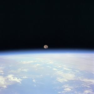 Moon Set and Earth Horizon Taken from Space Shuttle Discovery, July 14, 1995