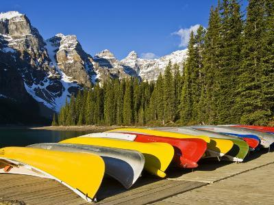 Moraine Lake and Rental Canoes Stacked, Banff National Park, Alberta, Canada-Larry Ditto-Photographic Print