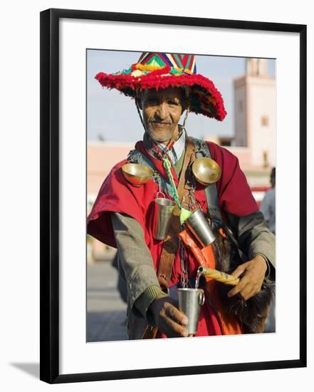 Moroccan Water Seller in Traditional Dress in the Djemaa El Fna, Marrakech-Julian Love-Framed Photographic Print
