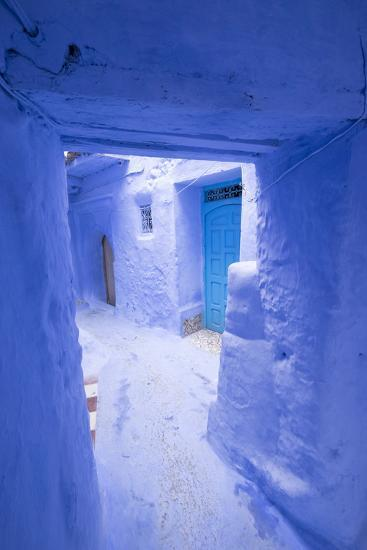 Morocco, Chaouen. Narrow Street Lined with Blue Buildings-Emily Wilson-Photographic Print