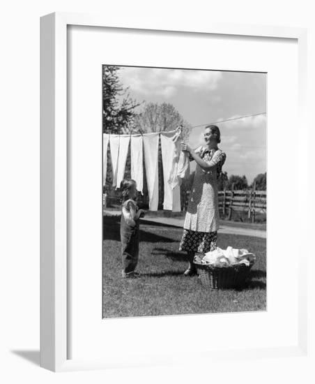 Mother and Daughter Doing Laundry, Hanging Wash on Clothesline in Backyard-H. Armstrong Roberts-Framed Photographic Print