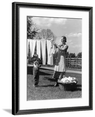Mother and Daughter Doing Laundry Hanging Wash-H. Armstrong Roberts-Framed Photographic Print