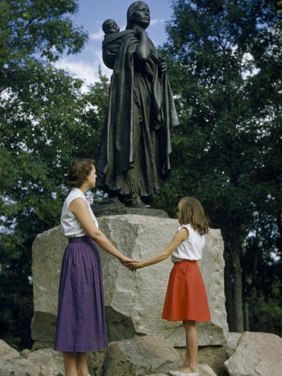 Mother and Daughter Holding Hands Stand Beside Statue of Sacagawea-Ralph Gray-Photographic Print