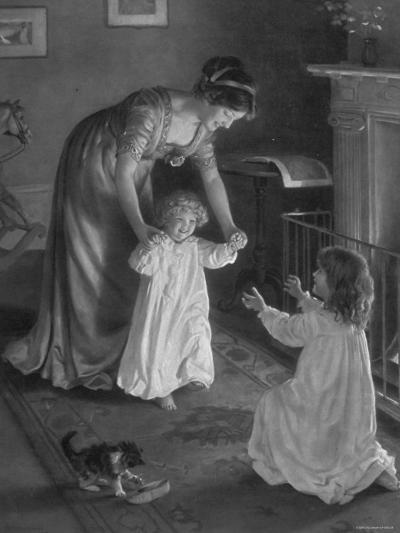 Mother with Daughters in Nightgowns, Helping Younger One Take Her First Steps--Photographic Print