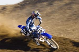 Motocross Racer on Dirt Track