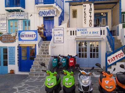 Motorbikes Parked Outside Shops-Diana Mayfield-Photographic Print