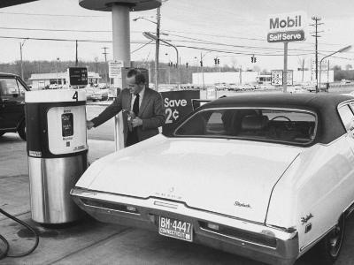 Motorist Filling Up His Own Car at a Self Service Gas Station-Ralph Morse-Photographic Print