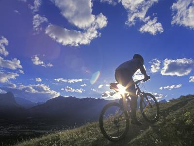 Mountain Biker at Sunset, Canmore, Alberta, Canada-Chuck Haney-Photographic Print