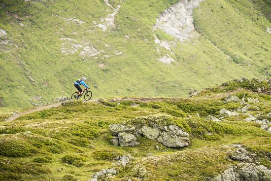 Mountain Biker In The Swiss Alps-Axel Brunst-Photographic Print