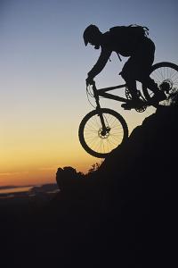 Mountain Biker Riding Down Slope