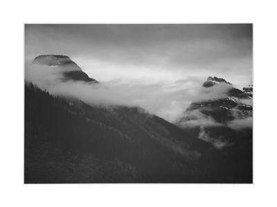 https://imgc.artprintimages.com/img/print/mountain-partially-covered-with-clouds-in-glacier-national-park-montana-1933-1942_u-l-q19qj3x0.jpg?p=0
