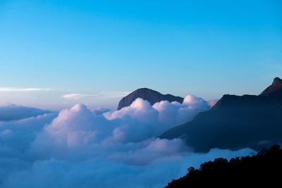Mountain Peaks Appear Out of Dense Clouds-Prasenjeet Yadav-Photographic Print