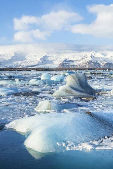 Mountains Behind the Icebergs Locked in the Frozen Water of Jokulsarlon Iceberg Lagoon-Neale Clark-Photographic Print