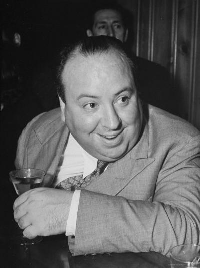 Movie Director Alfred Hitchcock Sits at Chasen's Bar While Enjoying a Cocktail Hour-Peter Stackpole-Premium Photographic Print