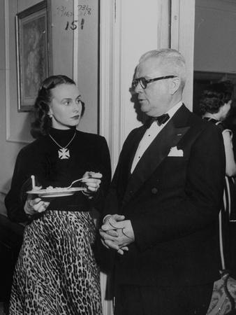 """Mrs. Austine Cassini and James K. """"Jake"""" Vardaman Talking During a Social Function--Photographic Print"""