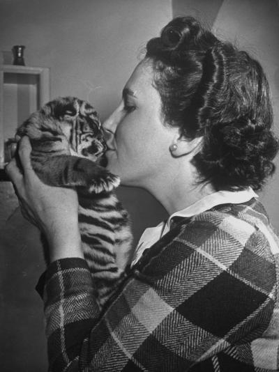 Mrs. Martini, Wife of the Bronx Zoo Lion Keeper, Kissing a Tiger Cub-Alfred Eisenstaedt-Photographic Print