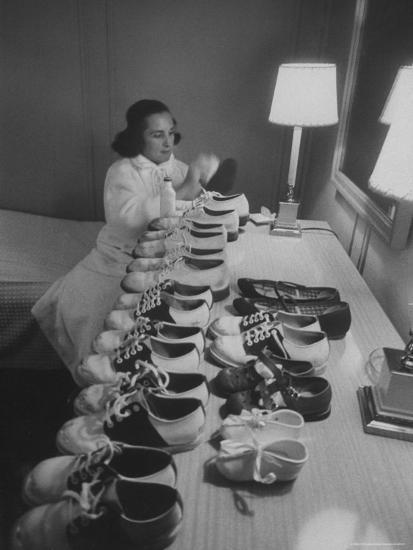 Mrs. Ottilie King Lining Up Her Children's Shoes-Stan Wayman-Photographic Print