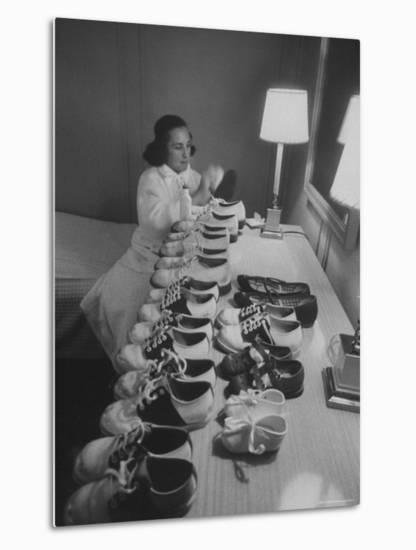 Mrs. Ottilie King Lining Up Her Children's Shoes-Stan Wayman-Metal Print