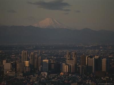 Mt. Fuji Looms in the Distance Over Tokyo's Skycrapers-Karen Kasmauski-Photographic Print
