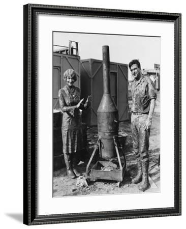 Mud Covered Couple with Portable Stove--Framed Photo