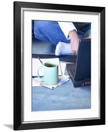 Mug of Coffee on Carpet Beside Laptop Computer--Framed Photographic Print