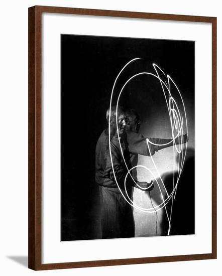 Multiple Exposure of Artist Pablo Picasso Using Flashlight to Make Light Drawing in the Air-Gjon Mili-Framed Premium Photographic Print