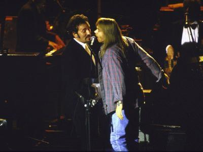 Musicians Bruce Springsteen and Axl Rose Performing