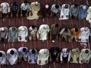 Muslim worshippers pray in Kuwait City's Grand Mosque just before dawn on September 17, 2009