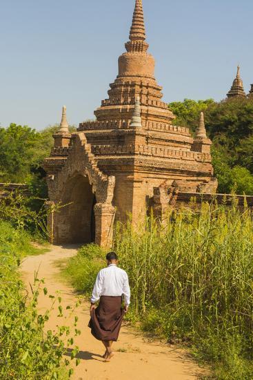 Myanmar. Bagan. Htilominlo Temple. Man Walking Towards the Temple Gate-Inger Hogstrom-Photographic Print