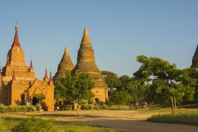 Myanmar. Bagan. Red Brick Temple Glows in the Late Afternoon Light-Inger Hogstrom-Photographic Print