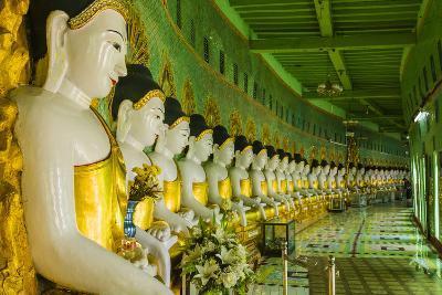 Myanmar. Mandalay. Sagaing Hill. Thirty Caves Temple. Row of Buddhas-Inger Hogstrom-Photographic Print