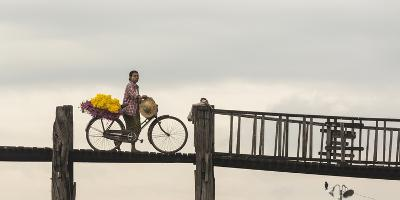 Myanmar, Mandalay. Woman Walks Her Flower-Laden Bicycle across U Bein Bridge-Brenda Tharp-Photographic Print