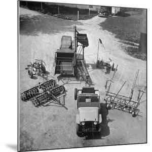 Farm Equipment Surrounding a Farmer's Jeep in Demonstration of Postwar Uses for Military Vehicles by Myron Davis