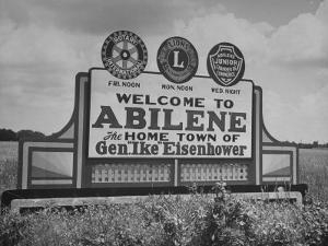 Highway Sign Welcoming Tourists to the Home Town of General Dwight D. Eisenhower by Myron Davis