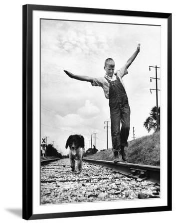 Larry Jim Holm with Dunk, His Spaniel Collie Mix, Walking Rail of Railroad Tracks in Rural Area