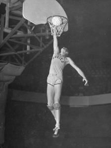 Texas A&M Basketball Player Bob Kurland Reaching to Make a Basket by Myron Davis