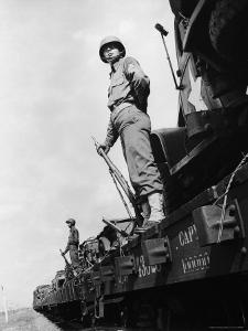 US Soldiers Standing Guard on a Troop Train by Myron Davis