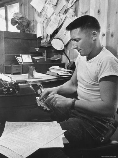 Mystery Writer Mickey Spillane Working at Typewriter at Desk Near Bulletin Board-Peter Stackpole-Premium Photographic Print