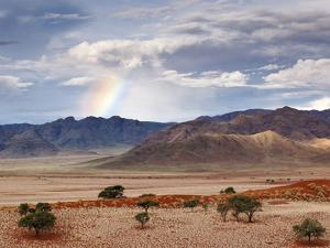 Rainbow, Namibia, Africa by Nadia Isakova