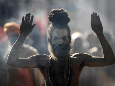 Naked Hindu Holy Man Performs Rituals on Banks of River Ganges During the Kumbh Mela in India--Photographic Print