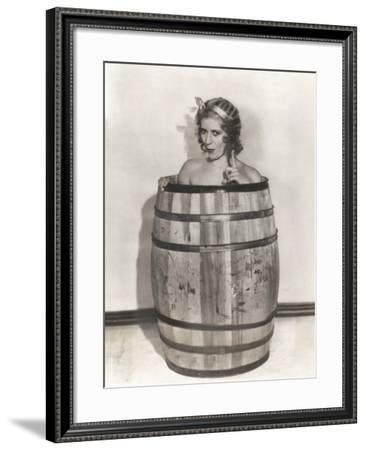 Naked Woman Sitting in Wooden Barrel--Framed Photo
