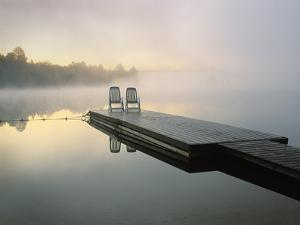 Chairs on Dock, Algonquin Provincial Park, Ontario, Canada by Nancy Rotenberg