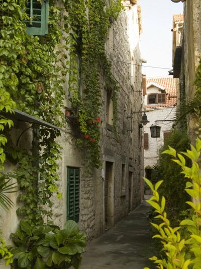 Narrow alley with historic stone buildings, Trogir, Dalamatia, Croatia-John & Lisa Merrill-Photographic Print